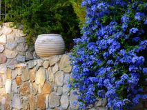 Large Ceramic Urn on Stone Wall Royalty Free Stock Photos