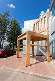 Large chair wooden sculpture near the furniture factory in Borov Stock Images