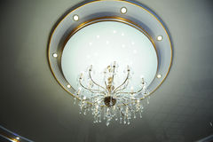 Large chandelier on the ceiling in the interior Royalty Free Stock Photography
