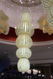 Large Chandelier in Fancy Hotel Resort. A very large chandelier hangs in the lobby of a fancy hotel resort stock photography