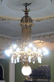 Large chandelier of yellow metal Royalty Free Stock Photo
