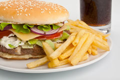 Large Cheeseburger with Fries Royalty Free Stock Photography