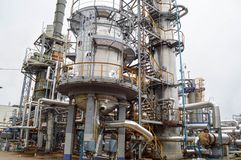 Large chemical capacity at the oil refinery equipment. Large chemical capacity at the oil refinery, new equipment. Oil and gas Royalty Free Stock Photos