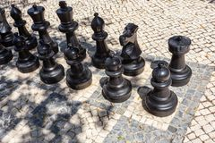 Large chess pieces for fun in the park. Stock Images