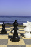Large chess pieces on an outdoor board Royalty Free Stock Photos