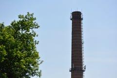 Large chimney on a blue sky background stock image