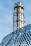 Large chimney steel. Blue sky Stock Photography