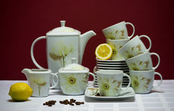 Large china tea-set with lemons and coffee beans Royalty Free Stock Images