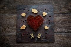 Valentine Heart Fudge on Slate and Dark Wood. Large chocolate fudge heart with red sprinkles surrounded by vanilla fudge cut into Valentine shapes on slate with Stock Photography