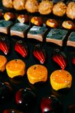 Large choice of handmade chocolates in rows. Close up royalty free stock photo