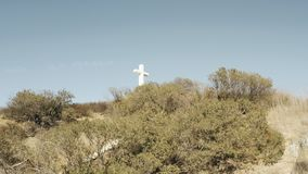 A large Christian cross on the top of a hill. Aerial View of a large Christian cross on the top of a hill. Need something more specific? Custom clips available stock video footage