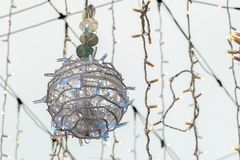 Large Christmas ball from a garland close up. Winter holiday street with garland royalty free stock photos