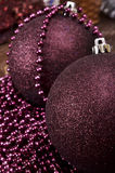Large christmas balls and beads on a wooden background Stock Images
