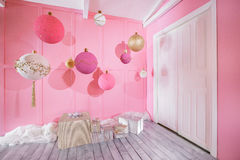 Large Christmas balls on a pink background in children room.  royalty free stock photography