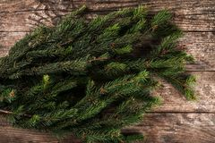 Large Christmas fir branch on a wooden holiday background. Xmas and New Year theme. Flat lay. Top view royalty free stock photos