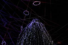 A large Christmas tree decorated with Christmas lights on the advent of Ptuj and the goddess in ornaments in the form of lines and. A large Christmas tree stock photography