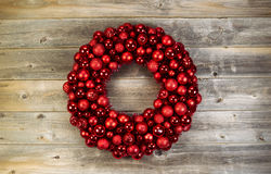 Large Christmas Wreath on Faded Wood Stock Photo