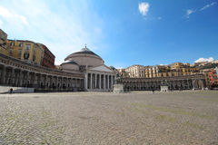 Large church in main square. Mostly empty, main square in Napoli, Italy, Piazza del Plebiscito with large church with roman design.  San Francesco di Paola Royalty Free Stock Images