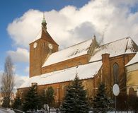 Large church in winter. A large church or cathedral with snow on the roof in winter Royalty Free Stock Photography