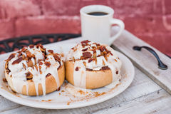 Large cinnamon rolls with a cup of coffee Stock Photo
