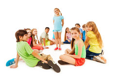 Large circle of kids and little girl in the middle Royalty Free Stock Image