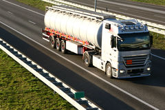 A Large Cistern Truck. A large cistern/tank truck on the highway Slight motion blur due to high speed movement of the truck Stock Image