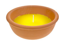 Large citronella candle in clay bowl. A large citronella candle in a red clay bowl on a white background Stock Images
