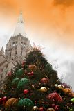 Large City Christmas Tree and Church. Large city christmas tree with church and dramatic sky in background Royalty Free Stock Photography