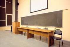 Large classroom, big blackboard, wooden table Royalty Free Stock Photography