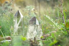 Large clear pure transparent great royal crystals of quartz chalcedony diamond brilliant on nature blurred bokeh autumn background stock photo