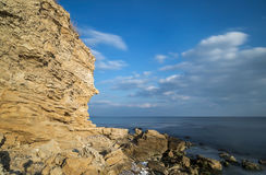 Large cliff on the sea coast Stock Images