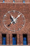 Large clock on City Hall (Radhuset), Oslo, Norway Stock Photos