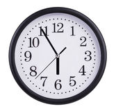 Large clock shows five to six Royalty Free Stock Images