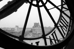 Large clocks with roman numerals in Museum d'Orsay. To Musee du Louvre in Paris, France (Black and White royalty free stock photo