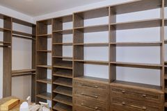 Large with in closet with many shelves and drawers. Large closet with Built in many shelves and drawers royalty free stock images