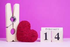Large clothespin, heart and wooden calendar. Funny card to the day of lovers. February 14 Valentine`s Day composition stock images