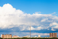Large cloud in blue sky over city with TV tower Royalty Free Stock Image