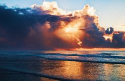 Clouds with Rain Showers during Sunrise in Myrtle Beach Stock Photos