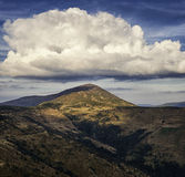 Large clouds above the Petros peak. Eastern Carpathians Royalty Free Stock Images