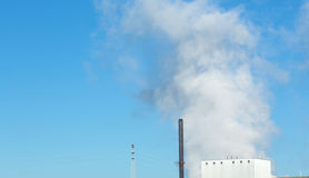 Large clouds of steam rising from a factory Stock Image
