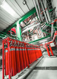 Large CO2 fire extinguishers. In industrial interior Royalty Free Stock Photo