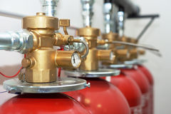 Large CO2 fire extinguishers. In a room Royalty Free Stock Photography