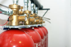 Large CO2 fire extinguishers. In a room Royalty Free Stock Photos