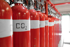 Large CO2 fire extinguishers. In a room Royalty Free Stock Image