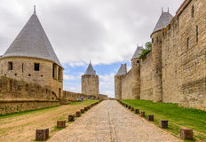 Large cobblestone street and fortification in Carcassonne Stock Image