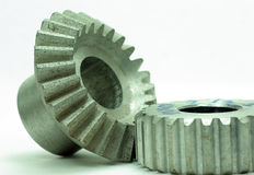 Large cog wheels in the motor. Accuracy ,blue  ,circle  ,classic,close ,cog,cogwheel Stock Photo