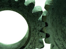 Large cog wheels in the motor. Accuracy  ,blue  ,circle,classic,close ,cog ,cogwheel  ,connection,cooperation,electric,engine,engineering Stock Photo
