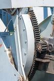 Large cogwheel. Metal Gear. The mechanism of the port crane. Old paint. Stock Photography