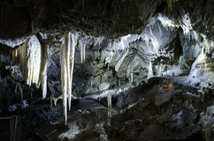 Large cold cave with stalactites and stalagmites Stock Photo