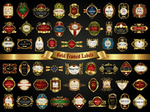 Large collection of colorful gold-framed labels in vintage style on a black background Stock Photos